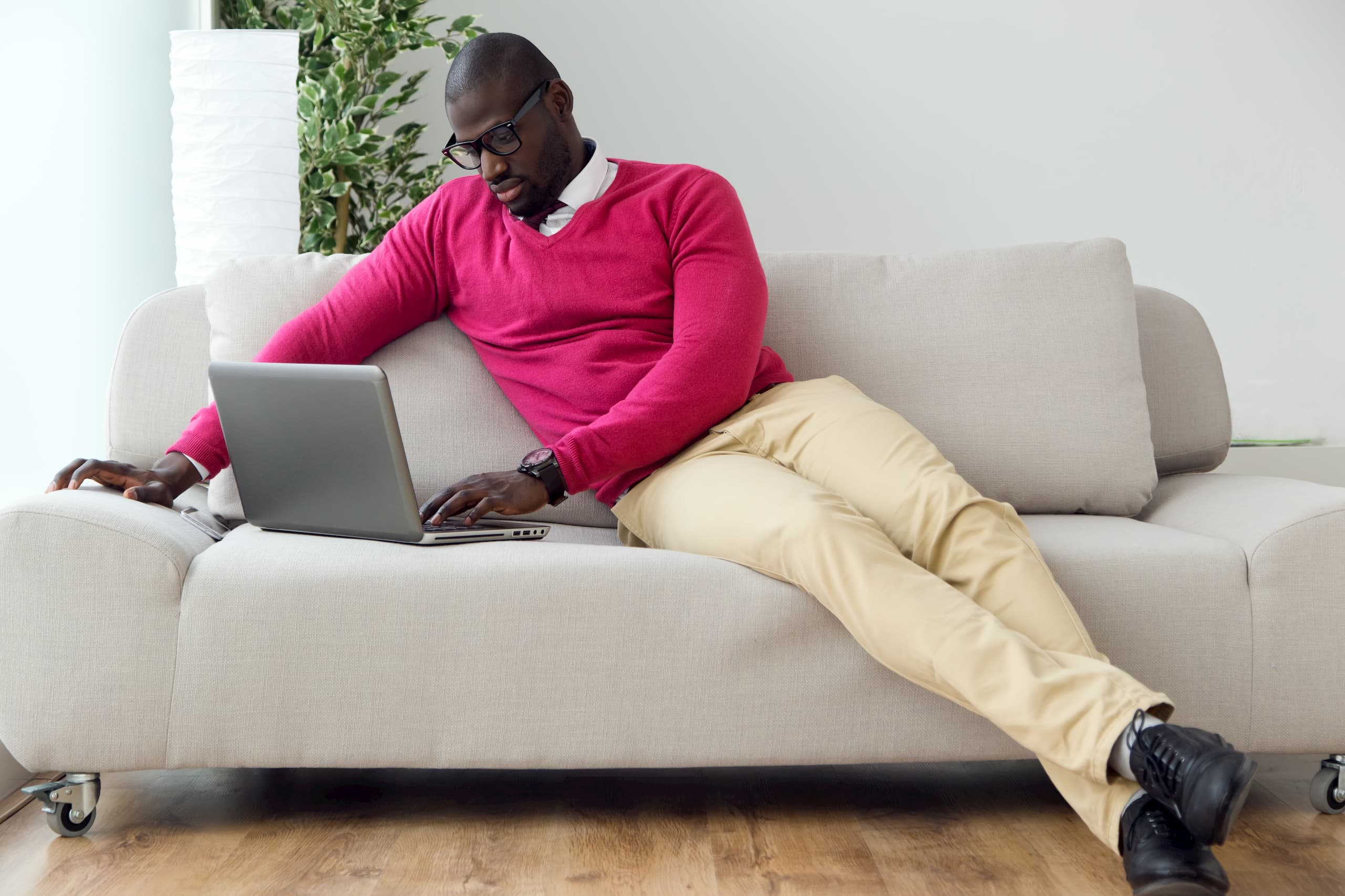 Man working on couch