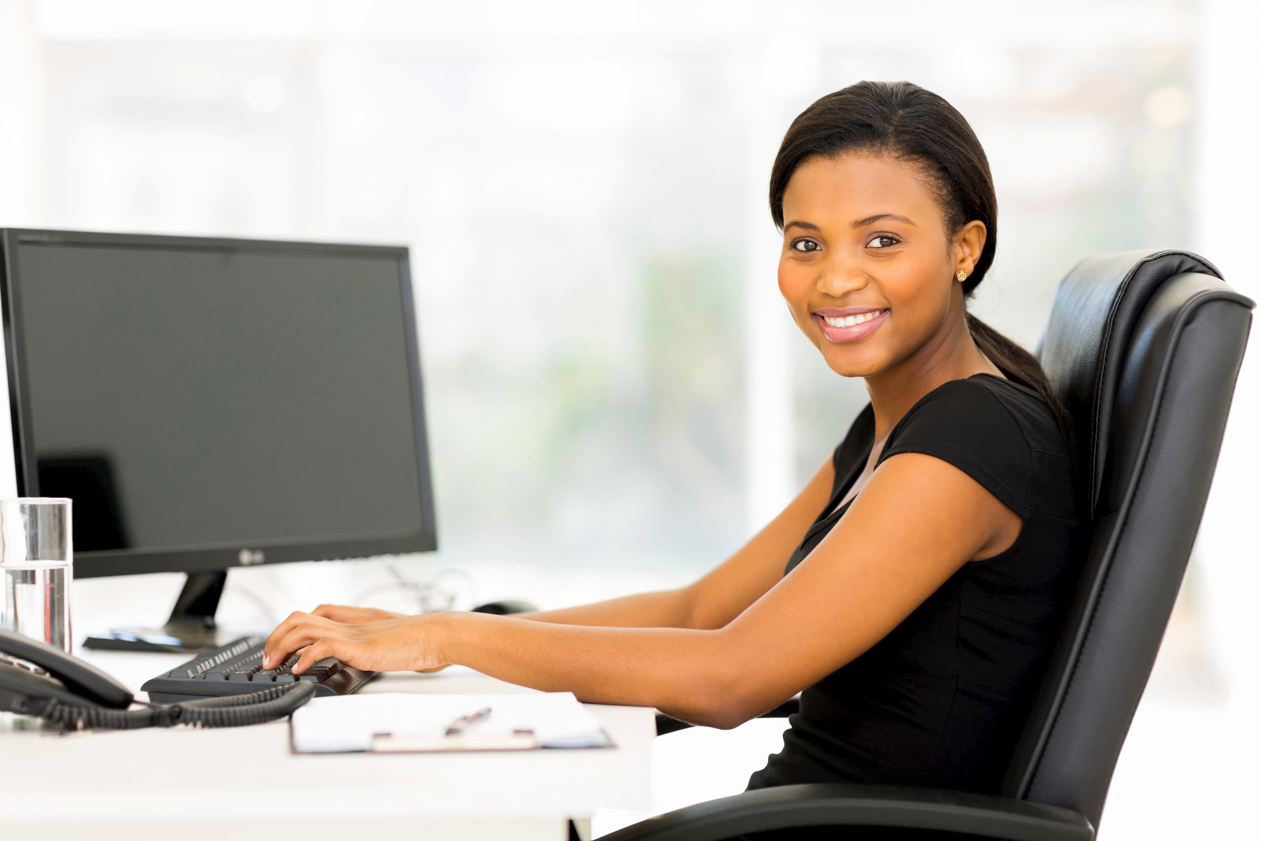 woman happy with her work from home ergonomics